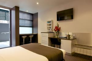 Кровать или кровати в номере Zero Davey Boutique Apartment Hotel