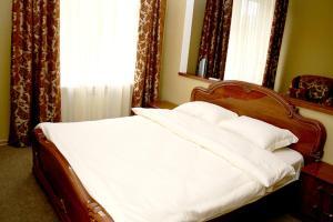 Кровать или кровати в номере Отель-курорт АЛЛЮР