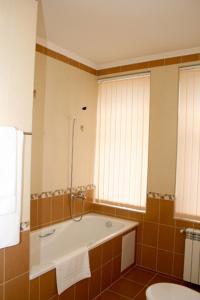 Ванная комната в Отель-курорт АЛЛЮР