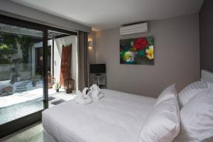 A bed or beds in a room at Be Loft B&B Pool & Spa