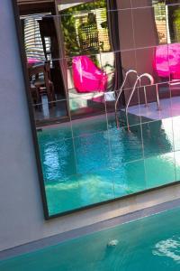 The swimming pool at or close to Be Loft B&B Pool & Spa