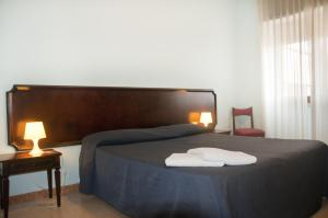 A bed or beds in a room at Residence Riva Gaia