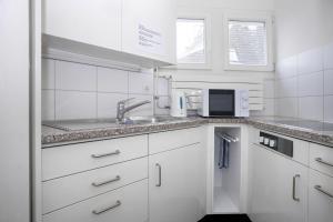 Кухня или мини-кухня в Hotel Hottingen
