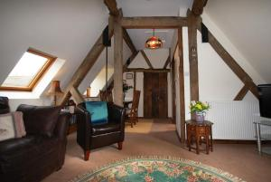 A seating area at Rafters at The Manor House