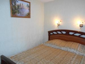 Кровать или кровати в номере Купеческий на Ленина