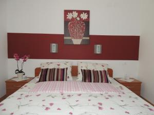 Postelja oz. postelje v sobi nastanitve Apartments and Rooms Tavcar