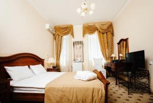 Cama o camas de una habitación en Business Hotel