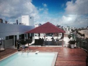 The swimming pool at or near Apartamento Beira Mar Manaíra