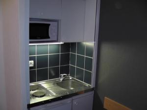 A kitchen or kitchenette at Marseille Prado Perier