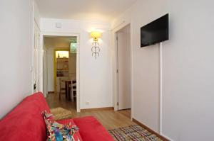"""A television and/or entertainment center at """"Maria""""- 2 Bedroom Apartment, Graça neighborhood"""