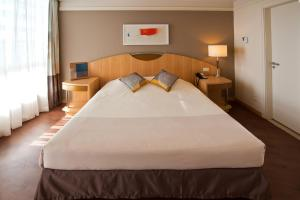 A bed or beds in a room at Novotel Sao Paulo Jaragua Conventions