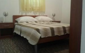 A bed or beds in a room at Bungalows Sport Center