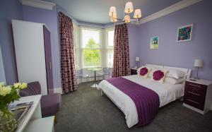 A bed or beds in a room at Studios At Glenthorne