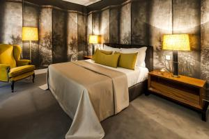 A bed or beds in a room at Cidnay Santo Tirso - Charming Hotel & Executive Center
