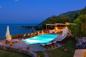 A view of the pool at Agapitos Villas & Guesthouses or nearby