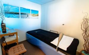 A bed or beds in a room at Forme-hotel & Spa Montpellier Sud-Est - Parc Expositions - Arena