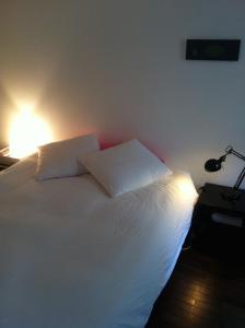 Un ou plusieurs lits dans un hébergement de l'établissement Chambre d'Hôtes Annelets