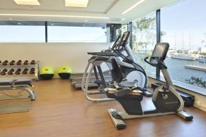The fitness center and/or fitness facilities at Courtyard by Marriott Gdynia Waterfront