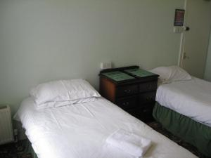 A bed or beds in a room at Aaran Central Guesthouse