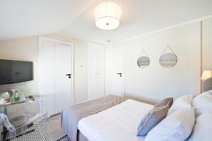 Łóżko lub łóżka w pokoju w obiekcie Monte Cassino