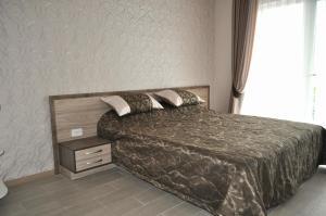 """Кровать или кровати в номере Апартаменты """"Ялта Мармарис"""""""