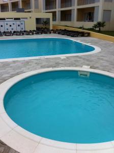 The swimming pool at or near Paraiso Dourado