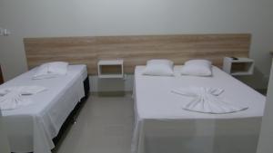 Cama ou camas em um quarto em Hotel Barril