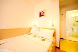 Voodi või voodid majutusasutuse Lazur Studio toas