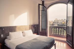 A bed or beds in a room at Casa Gracia