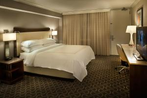 A bed or beds in a room at Marriott St. Louis Airport