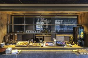 A kitchen or kitchenette at ibis budget Bordeaux Centre Bastide