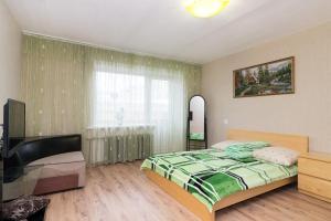"A bed or beds in a room at ""SelimVseh"" at Mamina-Sibiryaka"