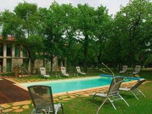 The swimming pool at or near Hôtel Les Esclargies