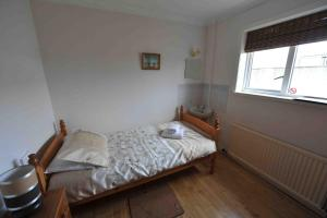 A bed or beds in a room at Sandwick Bay Guest House