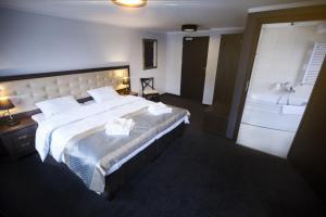 Łóżko lub łóżka w pokoju w obiekcie Villa Elizabeth