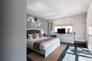 Ein Bett oder Betten in einem Zimmer der Unterkunft Alba Spa Hotel