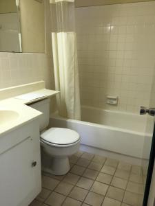 A bathroom at Stay Plus Inn