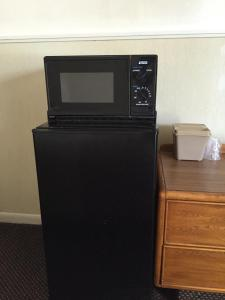 A television and/or entertainment center at Stay Plus Inn