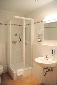 A bathroom at ANDI Stadthotel München