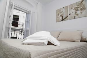 Cama o camas de una habitación en Apartamentos Casamonteymar Bas-Ser