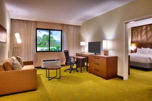 A television and/or entertainment center at Courtyard by Marriott Oahu North Shore