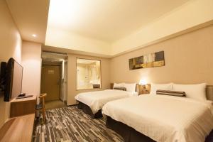 F HOTEL知本館房間的床