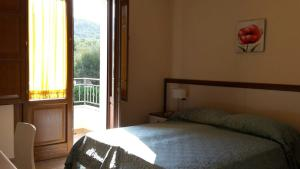A bed or beds in a room at Residence Sophora