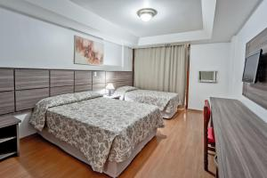 A bed or beds in a room at Dan Inn Planalto São Paulo