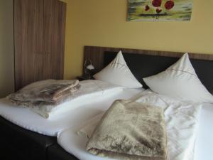 Een bed of bedden in een kamer bij Hotel Restaurant Jonkhans