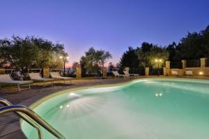 The swimming pool at or close to Villa Elaia