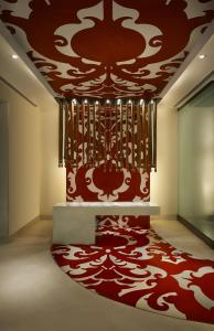 A bed or beds in a room at ITC Mughal, A Luxury Collection Resort & Spa, Agra
