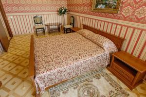 Кровать или кровати в номере Отель Гранд Тамбов