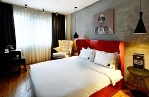 A bed or beds in a room at SuB Karakoy - Special Category