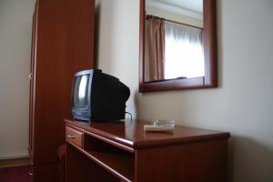 Uma televisão e/ou sistema de entretenimento em Residencial Dom Duarte